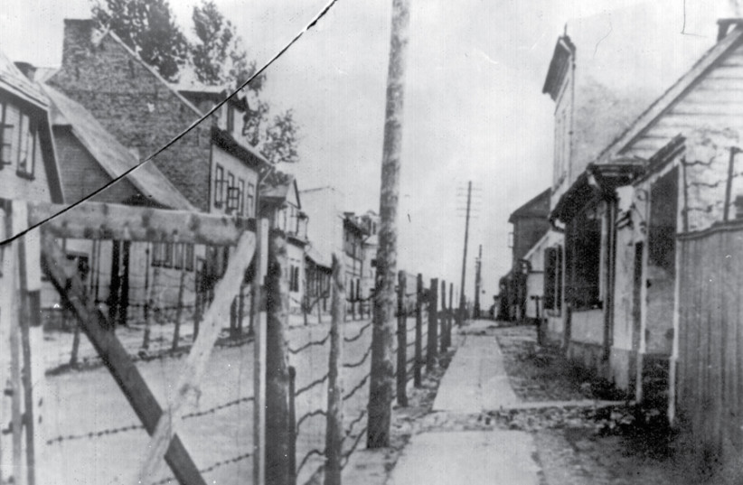 A BARBED-wire fence along Panrow Street, separating the two parts of the Kovno ghetto in Lithuania. (photo credit: COURTESY: YAD VASHEM PHOTO ARCHIVE)