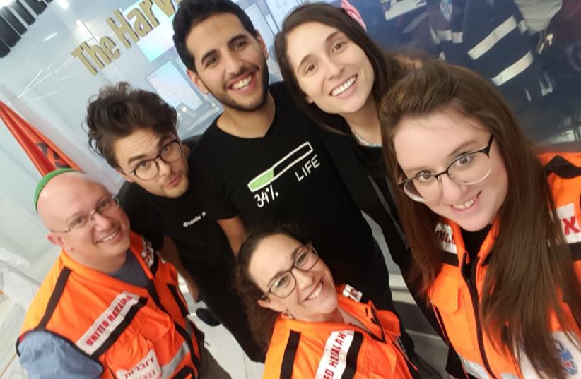 Israeli-Arab blogger Nuseir Yassin and United Hatzalah volunteers (photo credit: Courtesy)