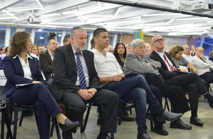 From Right: Avi Balashnikov, chairman of the college's board, former Supreme Court President Asher Grunis, college CEO Rafi Gamish, Attorney General Avichai Mandelblit and the college's law school dean Prof. Orit Afori.  (photo credit: IDAN GROSS)