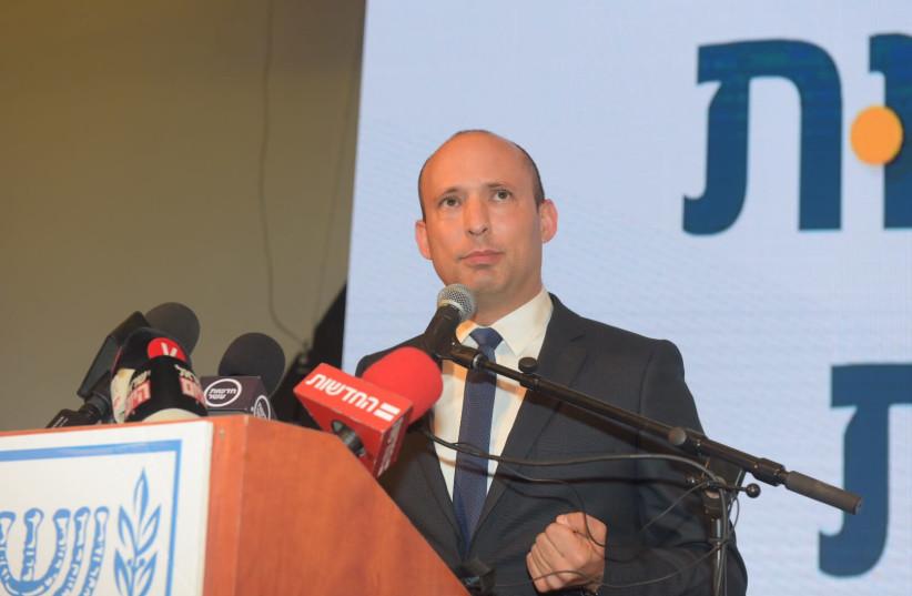 Education Minister Naftali Bennett speaking at a conference of the Education Ministry (photo credit: AVSHALOM SASSONI/ MAARIV)