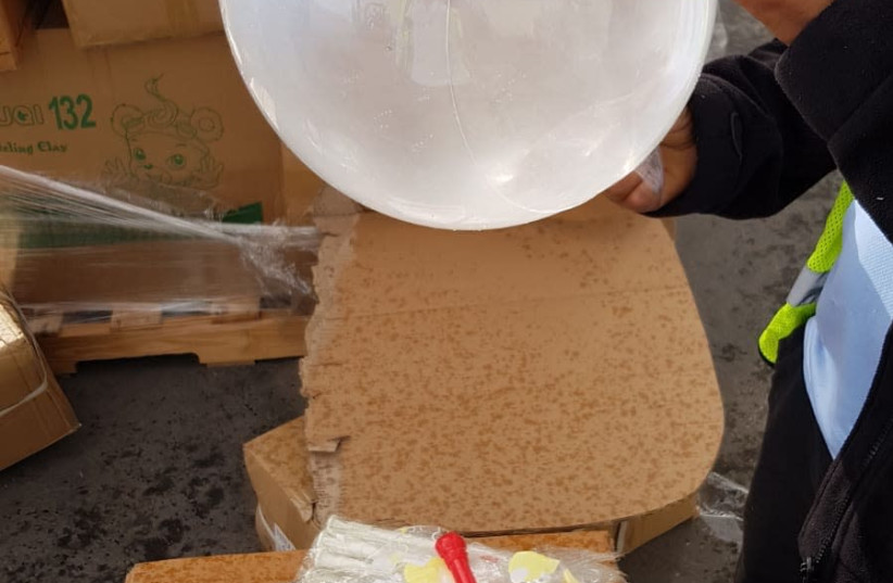 A balloon found at Gaza crossing to be used as an incendiary device. (photo credit: DEFENSE MINISTRY)