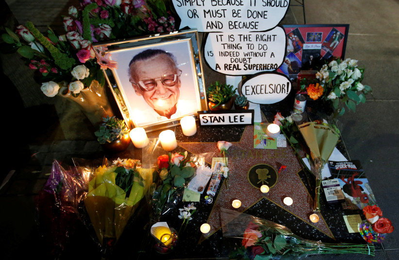 Flowers and mementos are pictured on the star of late Marvel Comics co-creator Stan Lee on the Hollywood Walk of Fame in Los Angeles, California, U.S., November 12, 2018.  (photo credit: MARIO ANZUONI/REUTERS)