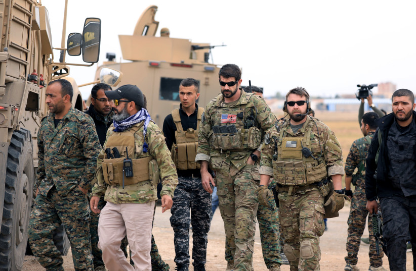 Syrian Democratic Forces and U.S. troops are seen during a patrol near Turkish border in Hasakah, Syria November 4, 2018 (photo credit: REUTERS/RODI SAID)