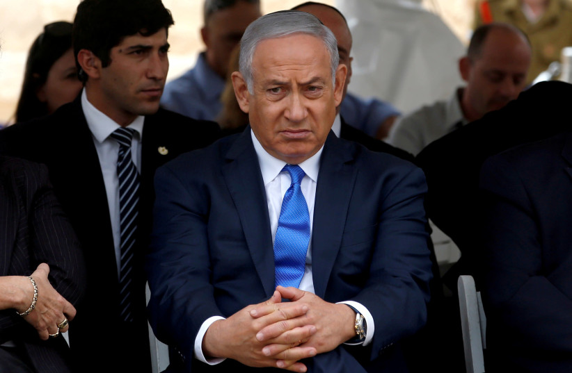 Israeli Prime Minister Benjamin Netanyahu attends an annual state memorial ceremony for Israel's first prime minister, David Ben Gurion, at his gravesite in Sde Boker, Israel November 14, 2018 (photo credit: RONEN ZVULUN/REUTERS)