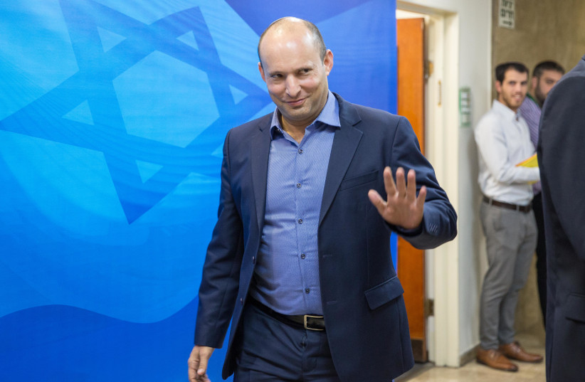 Naftali Bennett arrives at a weekly cabinet meeting, November 18, 2018 (photo credit: EMIL SALMAN/POOL)
