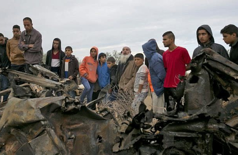 The remains of the car that was hit last week in Gaza. (photo credit: SAID KHATIB / AFP)