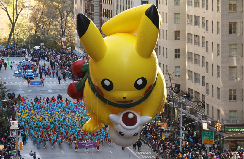 The Pikachu balloon make its way down 6th Ave during the 91st Macy's Thanksgiving Day Parade in the Manhattan borough of New York City, New York, U.S., November 23, 2017 (photo credit: REUTERS/CARLO ALLEGRI)