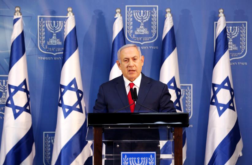 Prime Minister Benjamin Netanyahu delivers a statement to the members of the media in Tel Aviv (photo credit: CORINNA KERN/REUTERS)