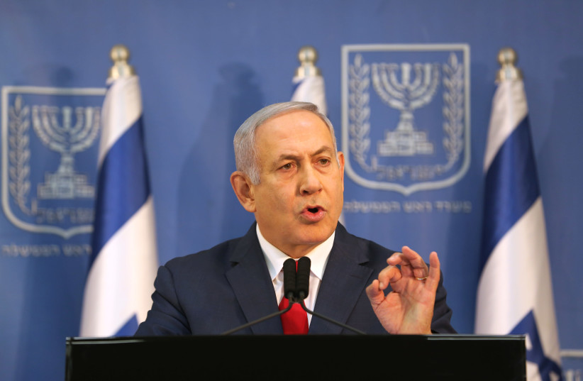 Israel's Prime Minister Benjamin Netanyahu delivers a statement to the members of the media in Tel Aviv, Israel November 18, 2018. (photo credit: REUTERS/CORINNA KERN)
