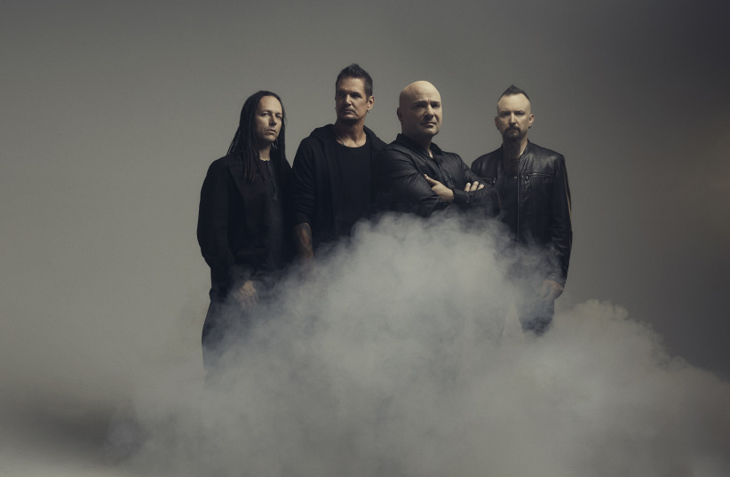 Disturbed, with David Draiman (third from left), are on the way to Israel.  (photo credit: Courtesy)