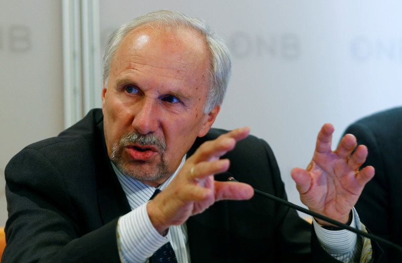 European Central Bank (ECB) Governing Council member and OeNB governor Ewald Nowotny addresses a news conference in Vienna, Austria, June 9, 2017.  (photo credit: REUTERS/LEONHARD FOEGER)