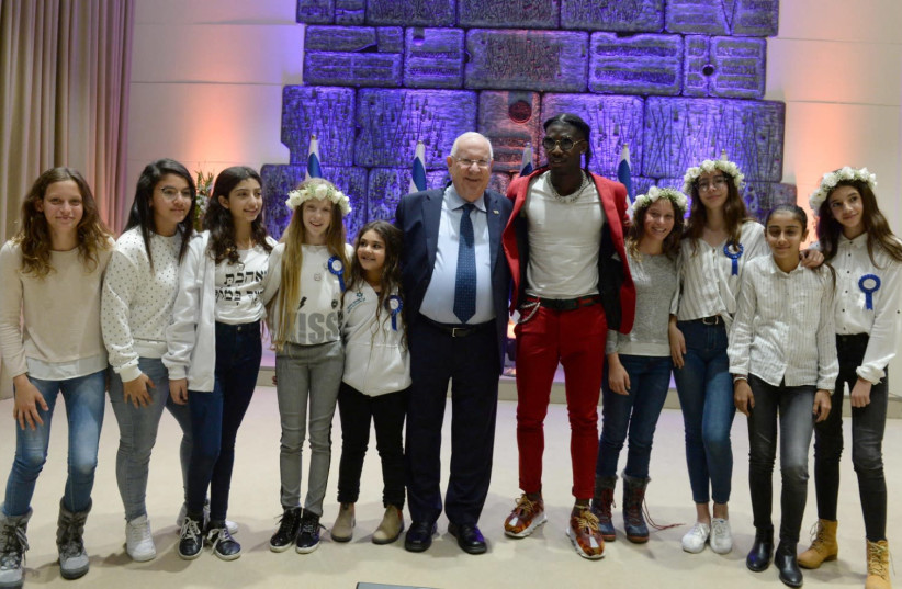 Rivlin hosted a  bar- and batmitzvah event for children of families affected in terrorist attacks. (photo credit: MARK NEIMAN)