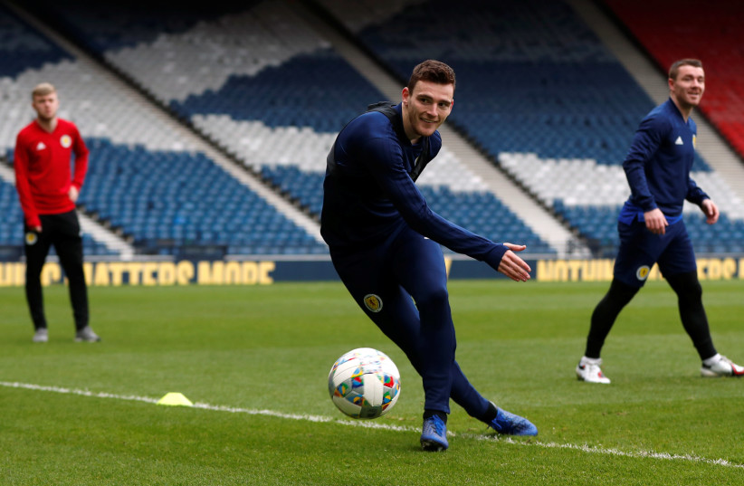 SCOTLAND'S ANDREW ROBERTSON prepares for the match against Israel yesterday at Hampden Park, in Glasgow.  (photo credit: ACTION IMAGES / LEE SMITH VIA REUTERS)
