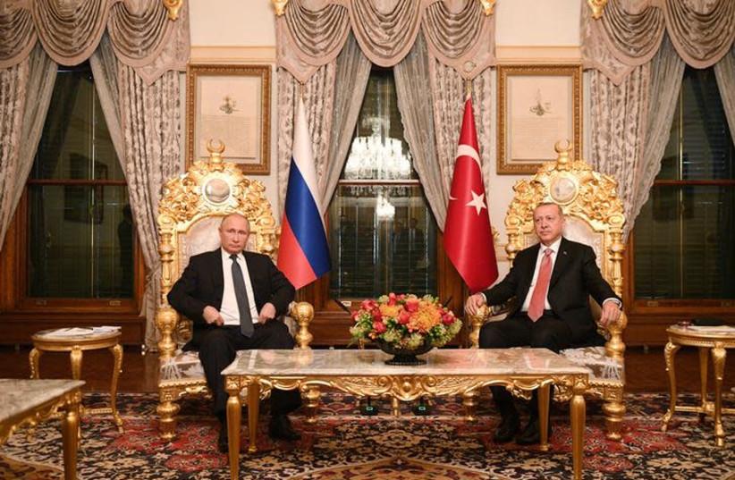 Russian President Vladimir Putin (L) meets with his Turkish counterpart Tayyip Erdogan in Istanbul, Turkey November 19, 2018 (photo credit: SPUTNIK/RAMIL SITDIKOV/POOL VIA REUTERS)