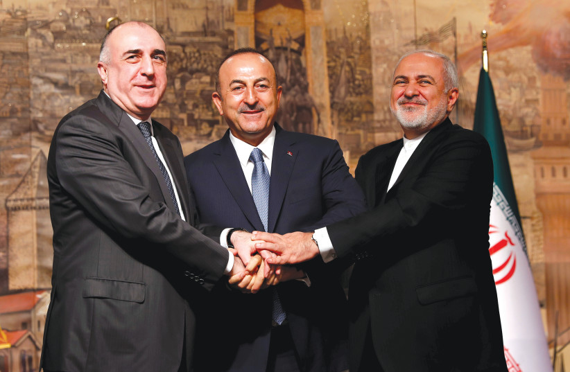 TURKISH FOREIGN Minister Mevlut Cavusoglu (center) poses with his counterparts Elmar Mammadyarov of Azerbaijan (left) and Javad Zarif of Iran following a news conference in Istanbul, Turkey in October. (photo credit: REUTERS)