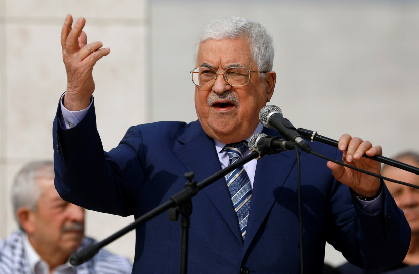 Palestinian President Mahmoud Abbas gestures as he speaks during a ceremony marking the 14th anniversary of the death of late Palestinian leader Yasser Arafat in Ramallah,  November 11, 2018 (photo credit: MOHAMAD TOROKMAN/REUTERS)