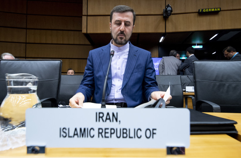 Recently appointed Iran's governor to IAEA Kazem Gharib Abadi prepares for the opening of the International Atomic Energy Agency (IAEA) Board of Governors meeting at the IAEA headquarters in Vienna, Austria on September 10, 2018 (photo credit: JOE KLAMAR / AFP)