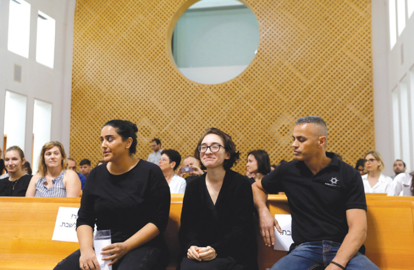 American student Lara Alqasem (center) appears in Israel's Supreme Court in Jerusalem on October 17 (photo credit: REUTERS)