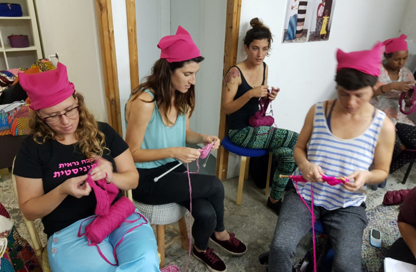Women knit pink hats with member of the Kuchinate, the African Refugee Women's Collective, in south Tel Aviv (photo credit: TEL AVIV SEXUAL ASSAULT CRISIS CENTER)
