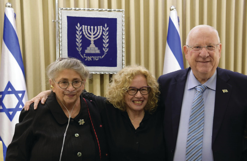 CHAVA ALBERSTEIN, flanked by President Reuven Rivlin and his wife, Necham (photo credit: MARC NEYMAN/GPO)