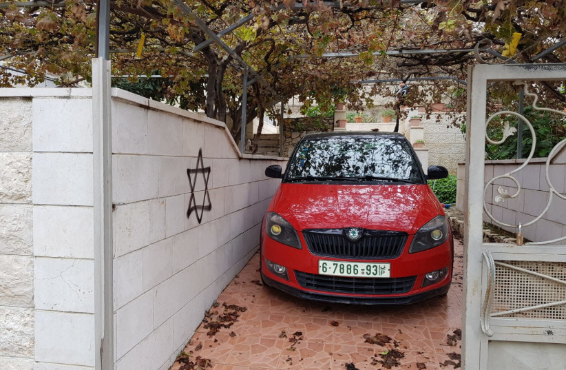 A vandalized car in the Palestinian village of Huwwara (photo credit: YESH DIN)
