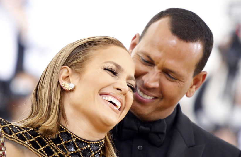 """Singer Jennifer Lopez and baseball personality Alex Rodriguez arrive at the Metropolitan Museum of Art Costume Institute Gala (Met Gala) to celebrate the opening of """"Heavenly Bodies: Fashion and the Catholic Imagination"""" in the Manhattan borough of New York, U.S., May 7, 2018.  (photo credit: REUTERS/EDUARDO MUNOZ)"""