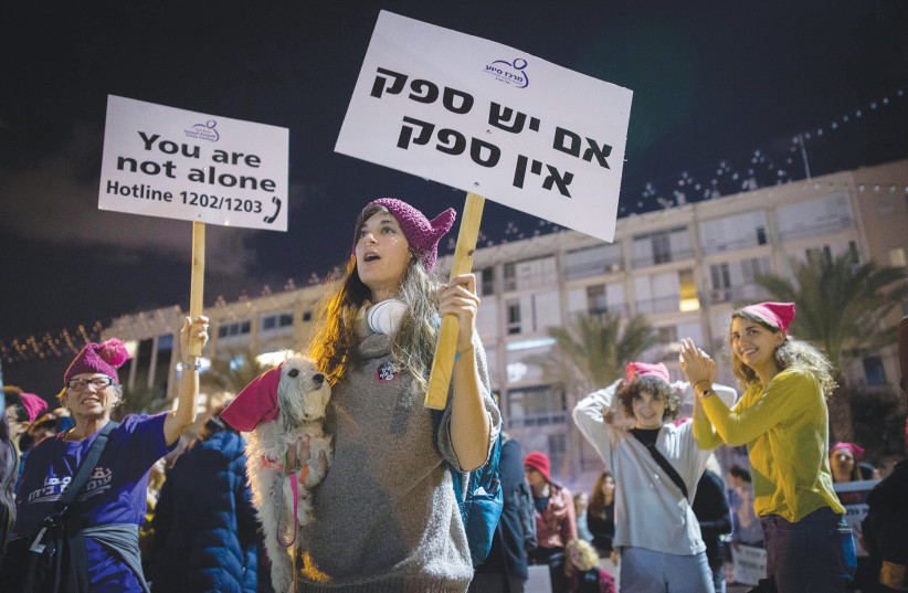 Demonstrators in Tel Aviv protest violence against women at a rally last night, marking the International Day for the Elimination of Violence against Women.  (photo credit: MIRIAM ALSTER/FLASH90)