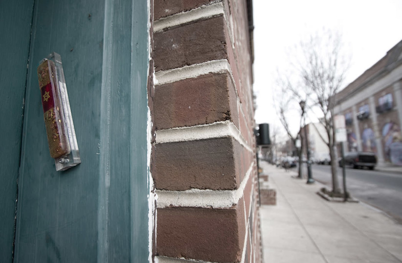 Mezuzah affixed to a door frame on South Street in Philadelphia. (photo credit: Wikimedia Commons)