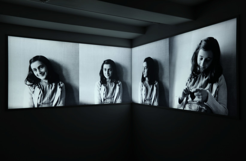 Photos of Anne Frank are seen at Anne Frank House museum in Amsterdam, Netherlands, November 21, 2018. (photo credit: REUTERS/EVA PLEVIER)