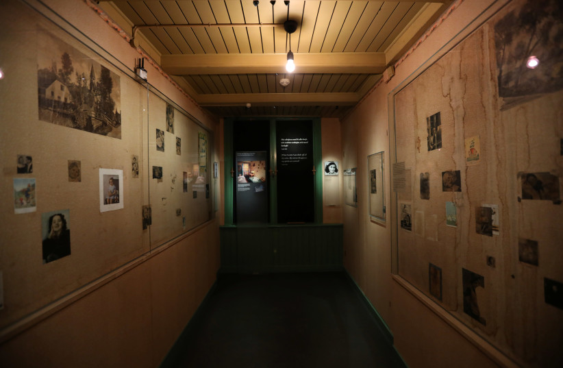 Photos are seen inside the Anne Frank House museum in Amsterdam, Netherlands, November 21, 2018.  (photo credit: REUTERS/EVA PLEVIER)