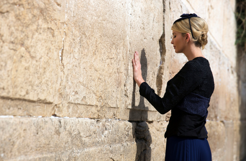 Ivanka Trump prays as she touches the Western Wall, Judaism's holiest prayer site, in Jerusalem's Old City May 22, 2017 (photo credit: HEIDI LEVINE/POOL/REUTERS)
