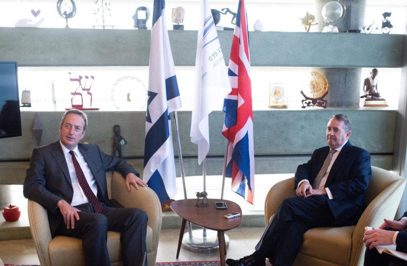 UK Secretary of State for International Trade, Liam Fox MP (right) and British Ambassador to Israel David Quarrey at Peres Centre for Peace and Innovation, November 27, 2018 (photo credit: BEN KELMER)