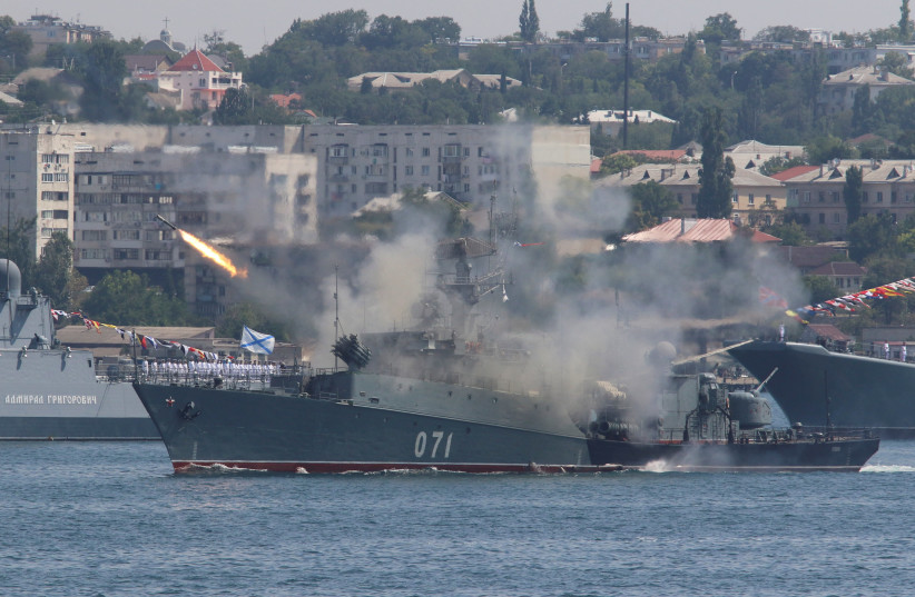 The Russian small anti-submarine ship Suzdalets fires a missile during a rehearsal for the Navy Day parade in the Black Sea port of Sevastopol, Crimea, July 27, 2017 (photo credit: PAVEL REBROV/REUTERS)