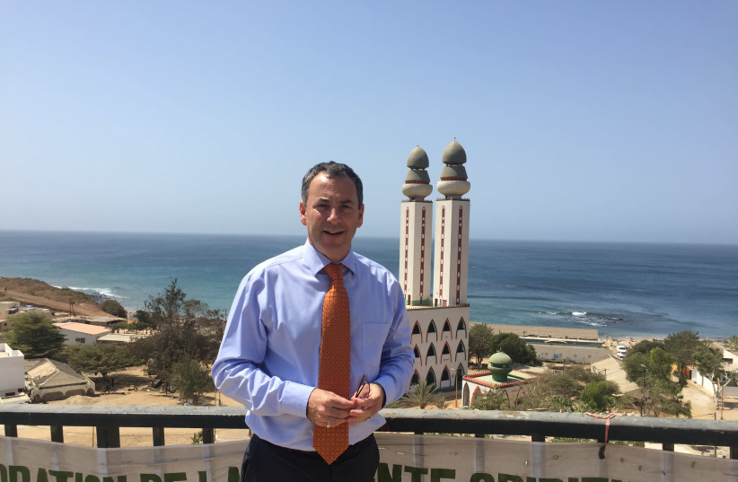 AMBASSADOR PAUL HIRSCHSON in front of the iconic Mosque of the Divinity in Dakar (photo credit: SETH J. FRANTZMAN)