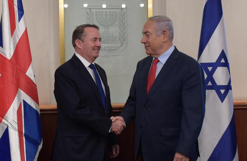 Prime Minister Benjamin Netanyahu meeting with British Trade Secretary Liam Fox, November 28, 2018 (photo credit: AMOS BEN-GERSHOM/GPO)