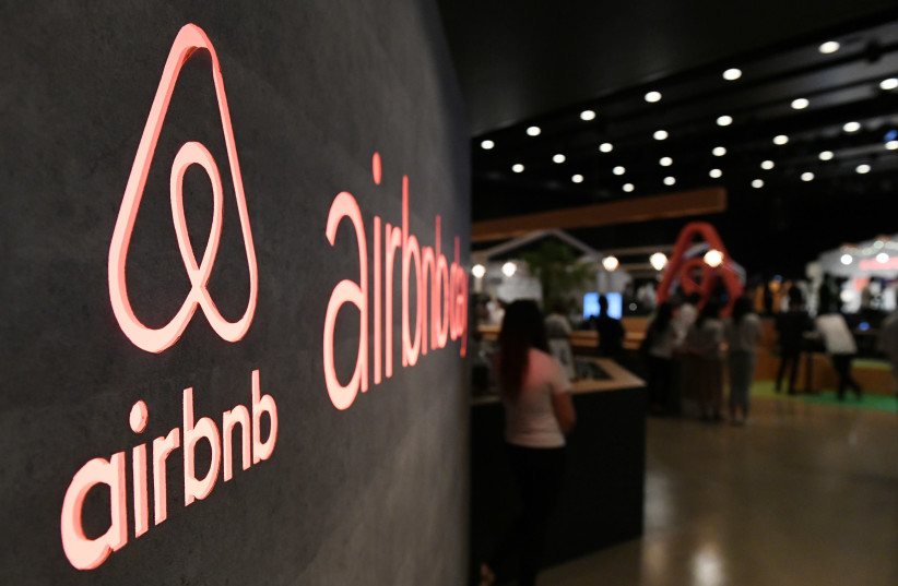 The US rental site Airbnb logo is displayed during the company's press conference in Tokyo on June 14, 2018 (photo credit: TOSHIFUMI KITAMURA / AFP)