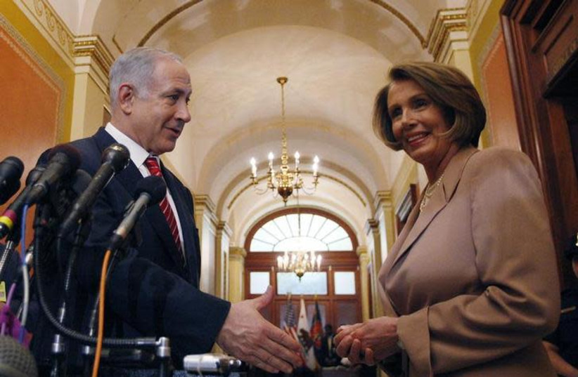 Israeli Prime Minister Benjamin Netanyahu reaches out to shake hands with Nancy Pelosi, Speaker of the U.S. House of Representatives, before their meeting on Capitol Hill in Washington May 19, 2009 (photo credit: JASON REED/REUTERS)