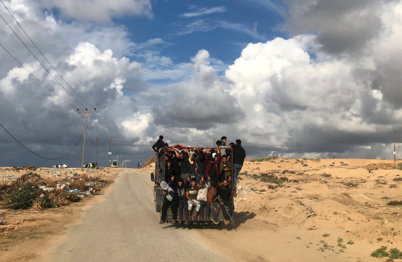 Palestinians ride a truck on their way to a protest calling for lifting the Israeli blockade on Gaza, near the beachfront border with Israel, in the northern Gaza Strip November 5, 2018 (photo credit: MOHAMMED SALEM/REUTERS)