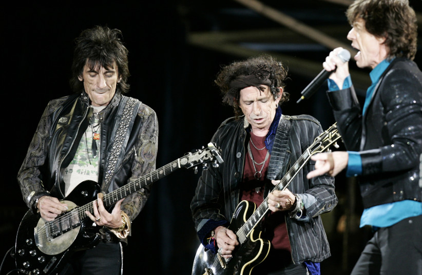 """Rolling Stones Ron Wood (L), Keith Richards (C) and Mick Jagger perform during a concert on the band's """"A Bigger Bang"""" European tour in Warsaw, July 25,2007 (photo credit: KASPER PEMPEL/REUTERS)"""