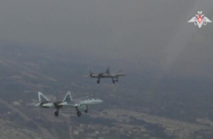 A still image, taken from a video footage and released by Russia's Defence Ministry on November 19, 2018, shows Sukhoi Su-57 jet fighters during a flight in Syria (photo credit: RUSSIAN DEFENSE MINISTRY/HANDOUT VIA REUTERS)