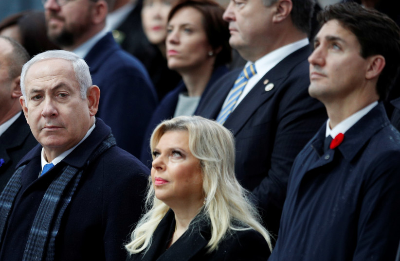 Israeli Prime Minister Benjamin Netanyahu, and his wife Sara, with Canadian Prime Minister Justin Trudeau attend a commemoration ceremony for Armistice Day, 100 years after the end of the First World War at the Arc de Triomphe, in Paris, France, November 11, 2018 (photo credit: FRANCOIS MORI/REUTERS)