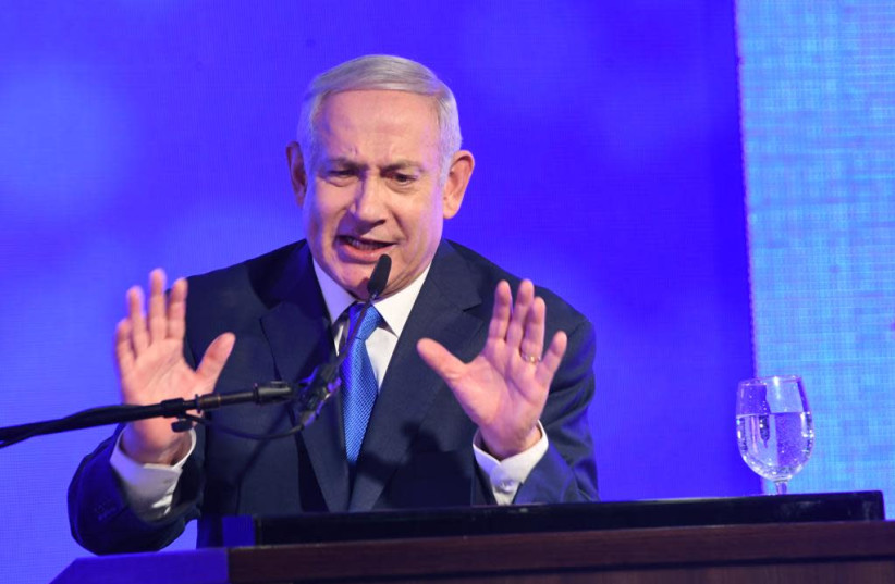 Prime Minister Benjamin Netanyahu speaks at a Likud Hannukah candle lighting, December 2, 2018 (photo credit: AVSHALOM SASSONI/ MAARIV)