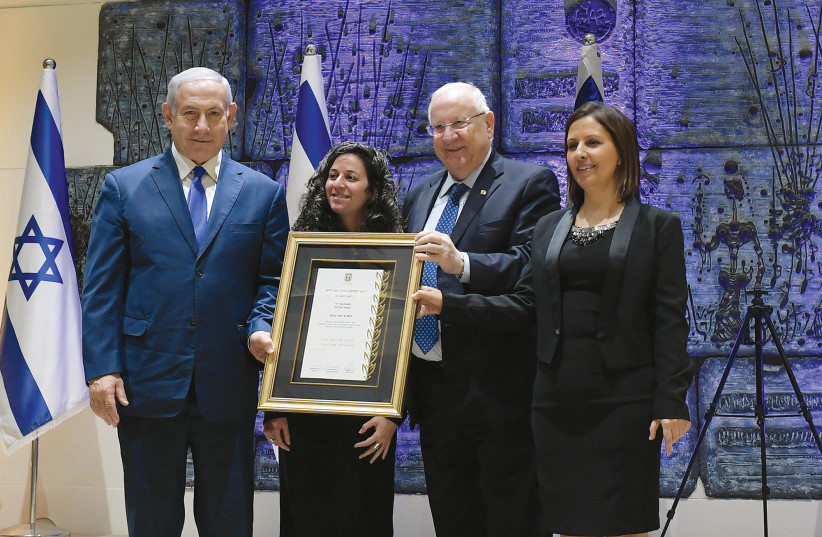 President Reuven Rivlin, Prime Minister Benjamin Netanyahu and Social Equality Minister Gila Gamliel spoke at an awards ceremony at the President's Residence in recognition of the dedication and devotion of the National Center for the Treatment of Survivors of Human Trafficking  (photo credit: AMOS BEN GERSHOM, GPO)