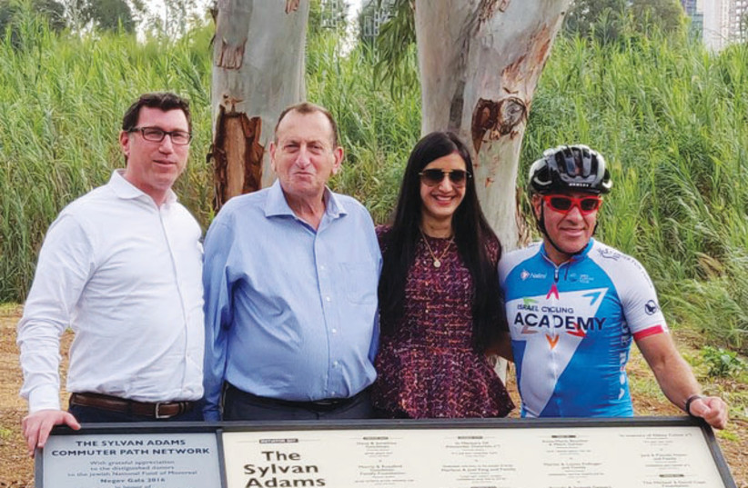 Tel Aviv Mayor Ron Huldai (second from left) and Canadian-Israeli philanthropist Sylvan Adams (right) inaugurated the first section of a 110-kilometer network of bicycle trails that will turn Tel Aviv into the Amsterdam of the Middle East on December 2, 2018 (photo credit: Courtesy)