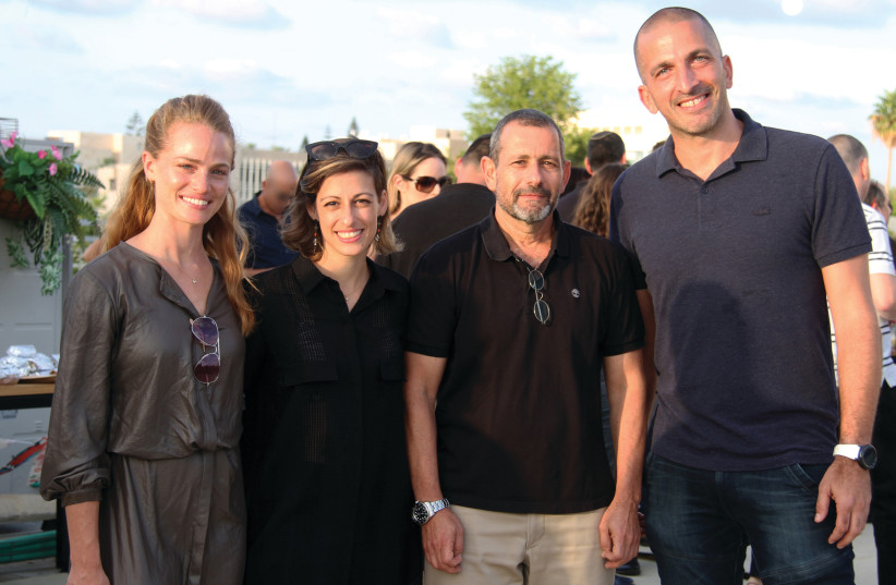Shin Bet director Nadav Argaman (second from right) with TAU Ventures managing PArtner Nimrod Cohen (right) and company staff  (photo credit: EYLON YEHIEL)