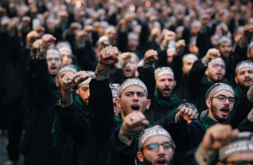 Lebanon's Hezbollah supporters chant slogans during last day of Ashura, in Beirut, Lebanon September 20, 2018 (photo credit: AZIZ TAHER/REUTERS)