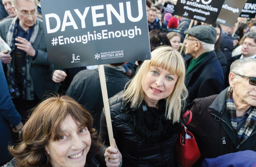 Marie van der Zyl (center) holds up a sign at the Enough is Enough demonstration in the UK on March 26, 2018 (photo credit: GARY PERLMUTTER)