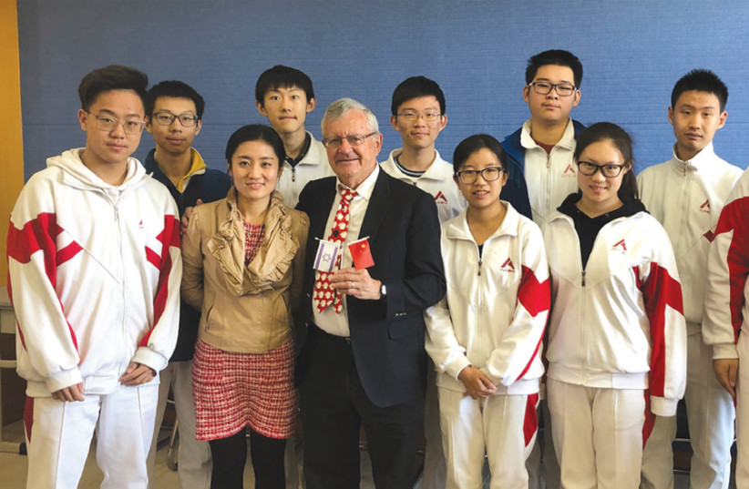 The writer and the Renmin University High School class, with the teacher, He Yuan, on his left and Guo Yuwei on his right (photo credit: Courtesy)