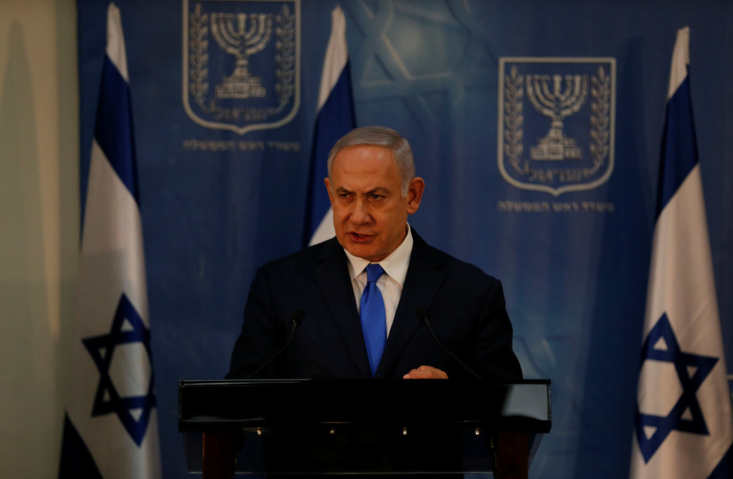 Israeli Prime Minister Benjamin Netanyahu delivers a statement to the media at the Defence Ministry in Tel Aviv, Israel December 4, 2018 (photo credit: AMMAR AWAD / REUTERS)