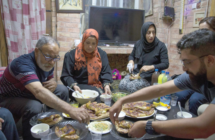 A Muslim family hosts Jewish Israelis at the traditional Iftar evening meal during Ramadan. (photo credit: OPEN HOLIDAYS)